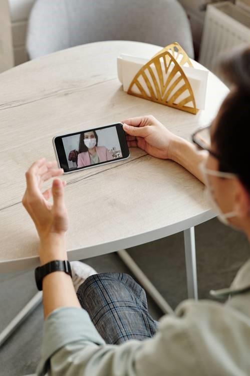 Man videoconferencing his doctor